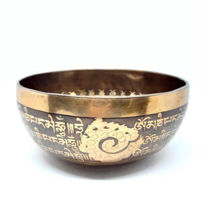 Cuenco tibetano grabado con símbolos budistas